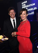 Director Paul WS Anderson and amfAR Ambassador Milla Jovovich attend amfAR LA Inspiration Gala honoring Tom Ford at Milk Studios on October 29 2014...