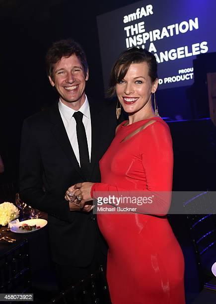 Director Paul WS Anderson and amfAR Ambassador Milla Jovovich attend amfAR LA Inspiration Gala honoring Tom Ford at Milk Studios on October 29 2014...