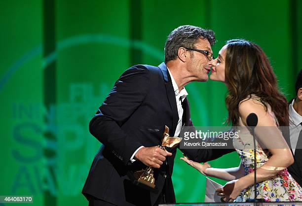 Director Pawel Pawlikowski accepts Best International Film for 'Ida' from actress Emmy Rossum onstage during the 2015 Film Independent Spirit Awards...