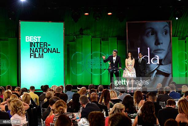 Director Pawel Pawlikowski accepts Best International Film for 'Ida' from actors Emmy Rossum and Michael Pena onstage during the 2015 Film...