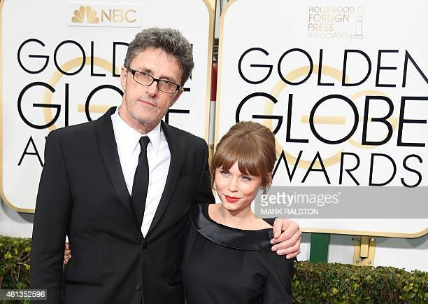 Director Pawel Pawlikowski and actress Agata Trzebuchowska of the nominated PolishDanish film 'Ida' arrive on the red carpet for the 72nd Annual...