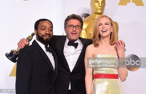 Director Pawel Pawlikowski poses with his Oscar for Best Foreign Film 'Ida' along with presenters actress Nicole Kidman and actor Chiwetel Ejiofor in...