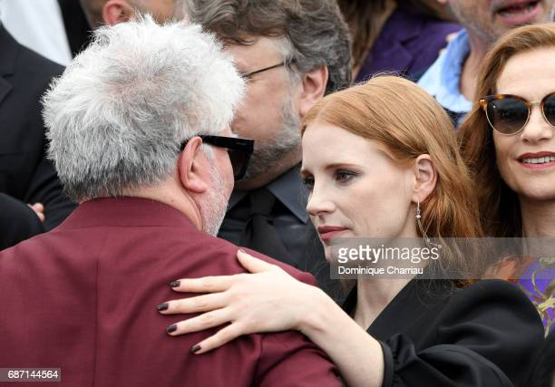 Director Pedro Almodovar actress Jessica Chastain and Isabelle Huppert attend the 70th Anniversary photocall during the 70th annual Cannes Film...