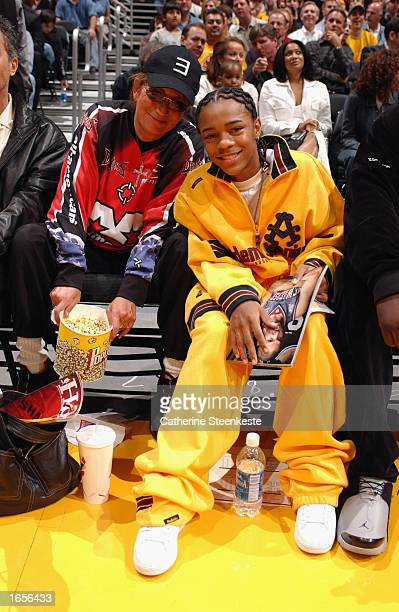 Director Penny Marshall and singer movie actor Lil' Bow Wow sit courtside during the NBA game between the Atlanta Hawks and the Los Angeles Lakers at...