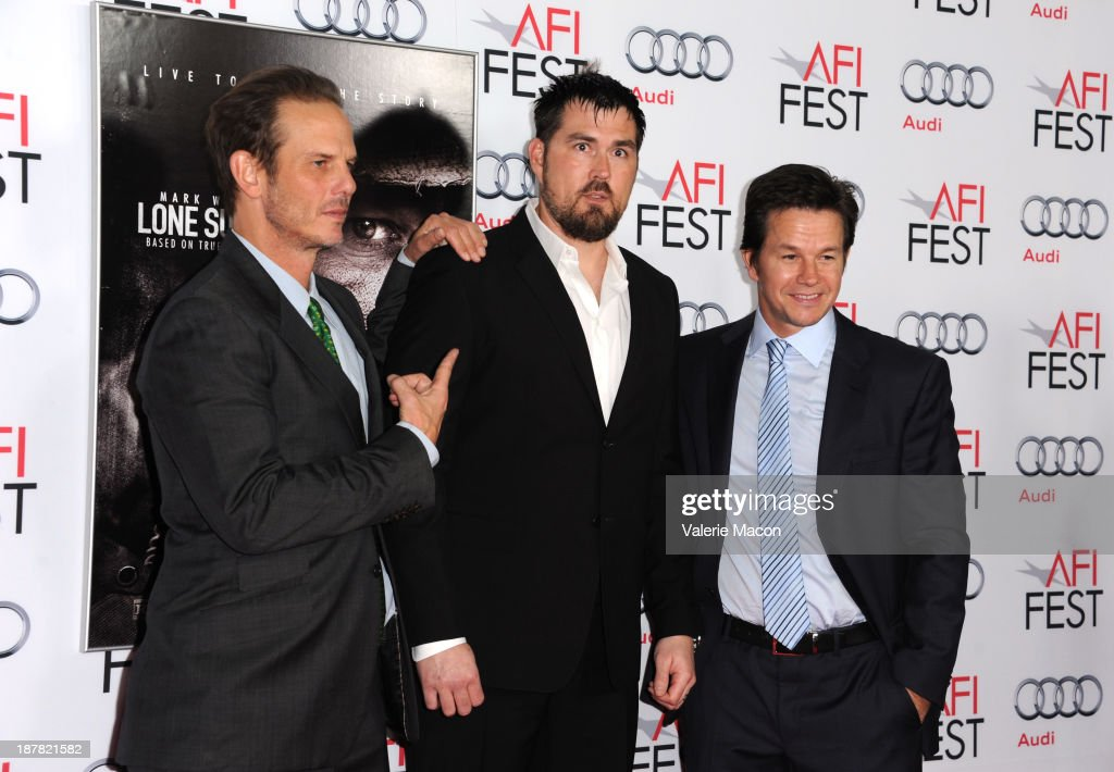 Director <a gi-track='captionPersonalityLinkClicked' href=/galleries/search?phrase=Peter+Berg&family=editorial&specificpeople=221450 ng-click='$event.stopPropagation()'>Peter Berg</a>, Marcus Luttrell, and actor <a gi-track='captionPersonalityLinkClicked' href=/galleries/search?phrase=Mark+Wahlberg&family=editorial&specificpeople=202265 ng-click='$event.stopPropagation()'>Mark Wahlberg</a> attend the premiere for 'Lone Survivor' during AFI FEST 2013 presented by Audi at TCL Chinese Theatre on November 12, 2013 in Hollywood, California.