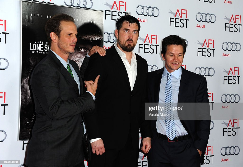Director Peter Berg, Marcus Luttrell, and actor Mark Wahlberg attend the premiere for 'Lone Survivor' during AFI FEST 2013 presented by Audi at TCL Chinese Theatre on November 12, 2013 in Hollywood, California.