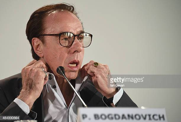 Director Peter Bogdanovich wearing a JaegerLeCoultre Master Hometime Aston Martin watch attends the 'She's Funny That Way' press conference before...