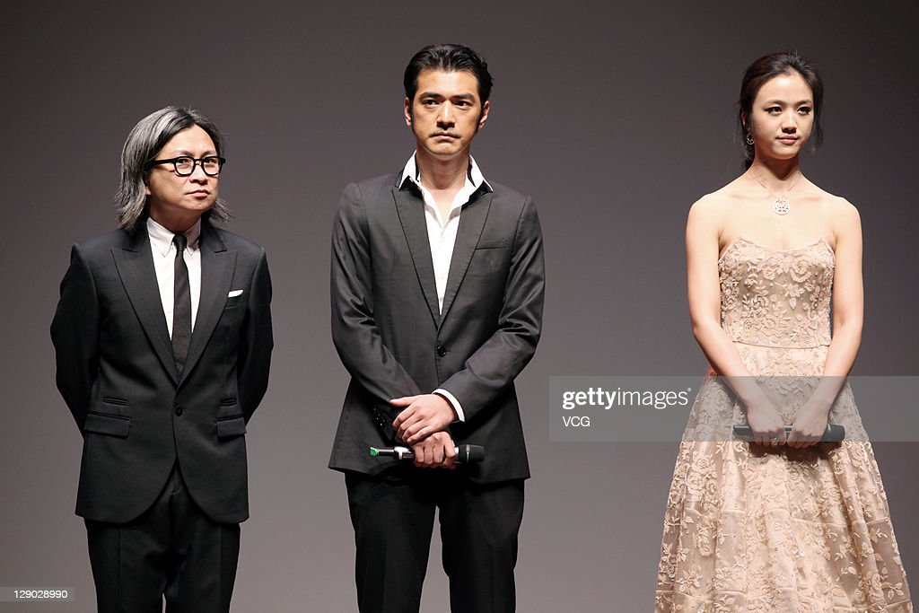 Director Peter Chan, actor Takeshi Kanashiro and actress <a gi-track='captionPersonalityLinkClicked' href=/galleries/search?phrase=Tang+Wei&family=editorial&specificpeople=4329520 ng-click='$event.stopPropagation()'>Tang Wei</a> attend 'Wu Xia' premiere at Haneulyeon Theatre during the 16th Busan International Film Festival (BIFF) on October 9, 2011 in Busan, South Korea.