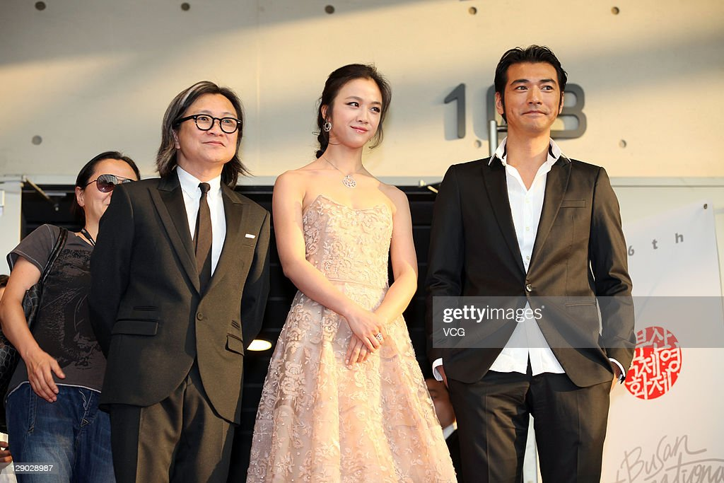 Director Peter Chan, actress <a gi-track='captionPersonalityLinkClicked' href=/galleries/search?phrase=Tang+Wei&family=editorial&specificpeople=4329520 ng-click='$event.stopPropagation()'>Tang Wei</a> and actor Takeshi Kanashiro attend 'Wu Xia' premiere at Haneulyeon Theatre during the 16th Busan International Film Festival (BIFF) on October 9, 2011 in Busan, South Korea.