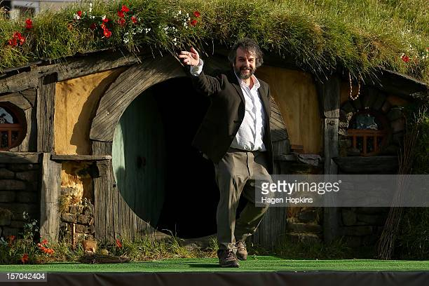 Director Peter Jackson emerges from from a Hobbit house before delivering a speech at the 'The Hobbit An Unexpected Journey' World Premiere at...