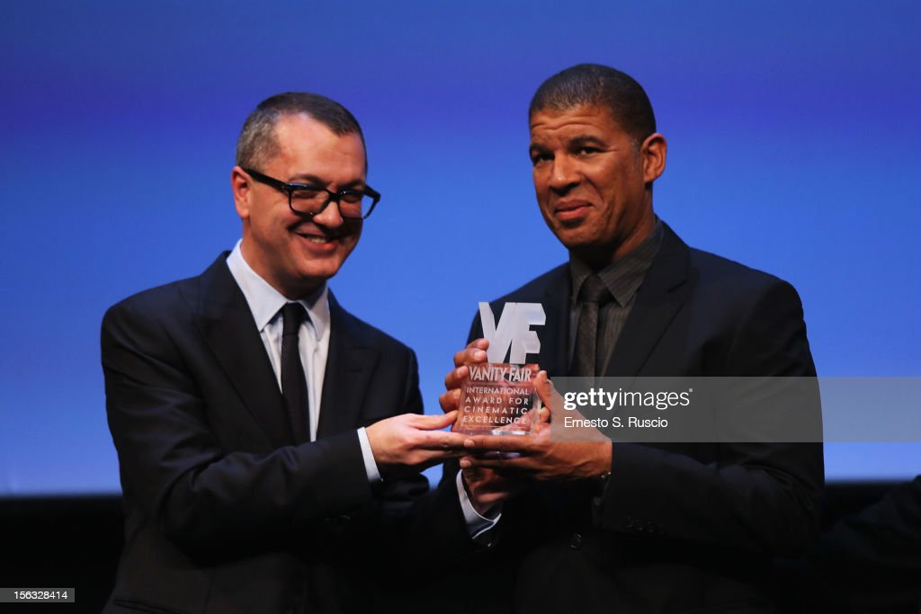 Director Peter Ramsey (R) collects the Vanity Fair International Award for Cinematic Excellence for the film 'Rise of the Guardians' with Pappi Corsicato (L) during a presentation at the 7th Rome Film Festival on November 13, 2012 in Rome, Italy.