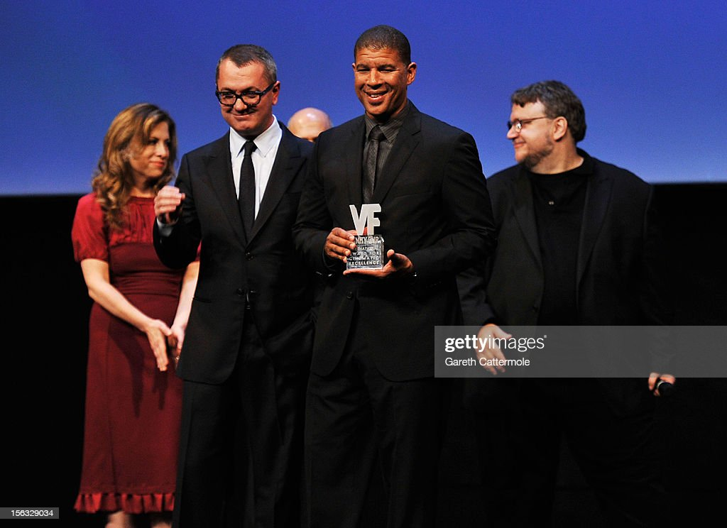Director Peter Ramsey collects the Vanity Fair International Award for Cinematic Excellence for the film 'Rise of the Guardians' from Pappi Corsicato (L) during a presentation at the 7th Rome Film Festival on November 13, 2012 in Rome, Italy.