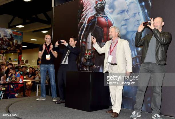 Director Peyton Reed actors Paul Rudd Michael Douglas and Corey Stoll onstage during Marvel's 'AntMan' Hall H Panel Booth Signing during ComicCon...