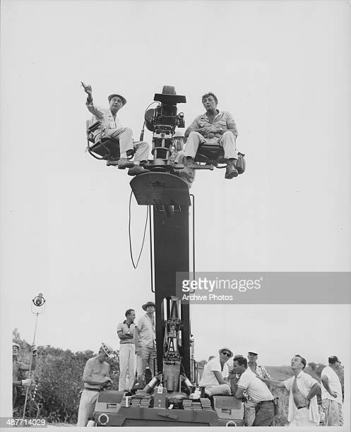 Director Phil Karlson and actor Robert Mitchum on a camera crane on the set of the movie 'Rampage' Hawaii 1962