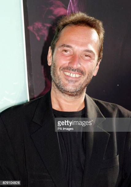 Director Pitof arrives for the premiere of his latest film Catwoman held at the Cinerama Dome Theatre Los Angeles USA