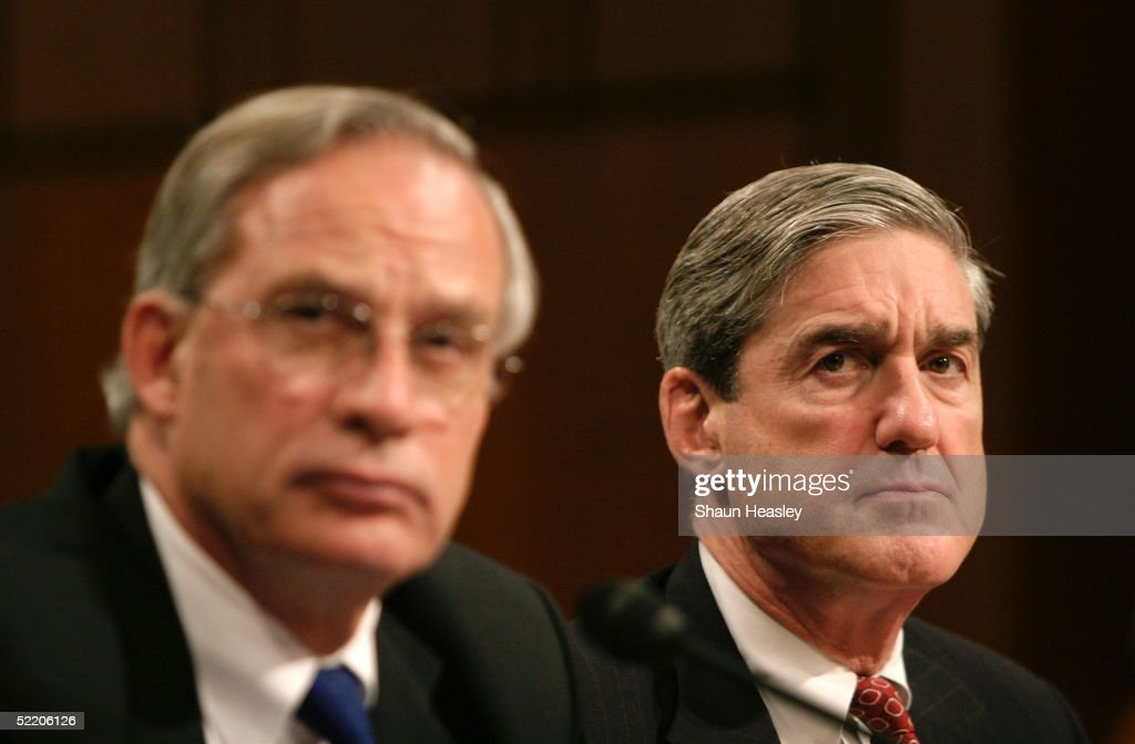 Director Porter Goss and FBI Director Robert Mueller look on during testimony before the Senate Select Intelligence Committee at the Hart Senate...