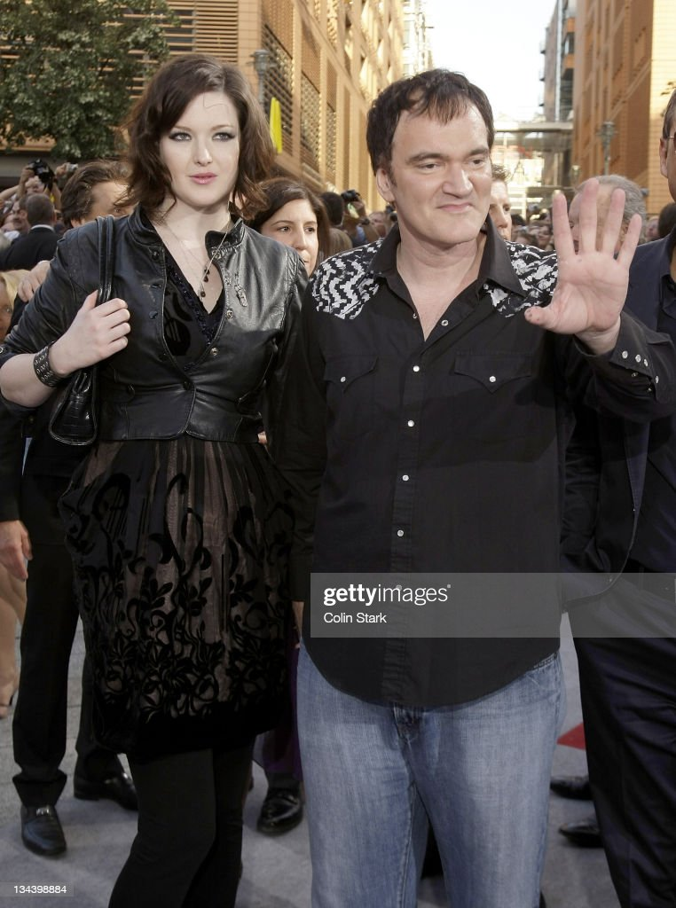 Director <a gi-track='captionPersonalityLinkClicked' href=/galleries/search?phrase=Quentin+Tarantino&family=editorial&specificpeople=171796 ng-click='$event.stopPropagation()'>Quentin Tarantino</a> and a guest arrive for the Germany premiere of 'Inglourious Basterds' at the Theater am Potsdamer Platz on July 28, 2009 in Berlin, Germany.