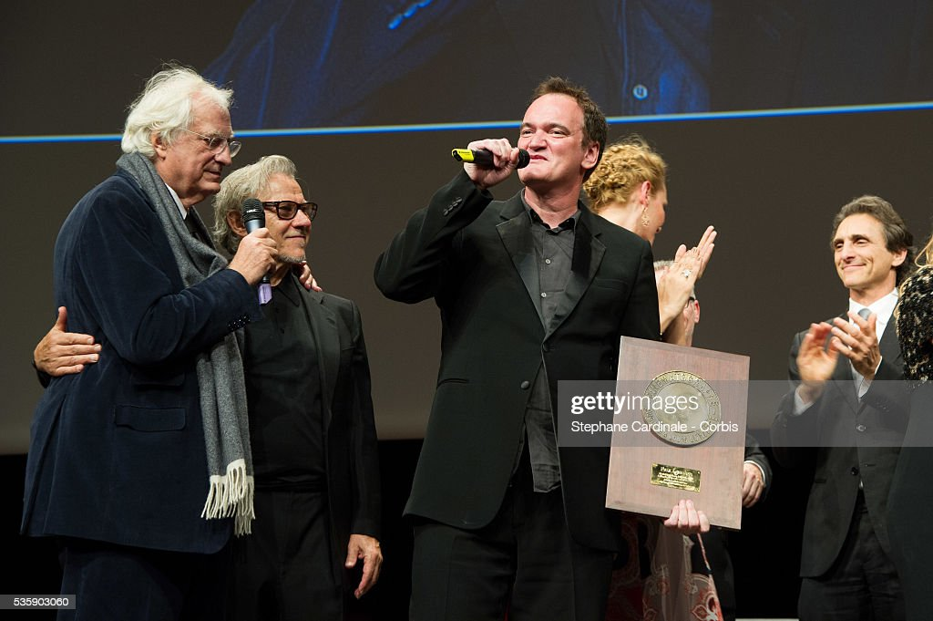 US Director Quentin Tarantino delivers a speech next to Bertrand Tavernier and Harvey Keitel, after receiving the Lumiere Award, during the 5th Lumiere Film Festival, in Lyon.