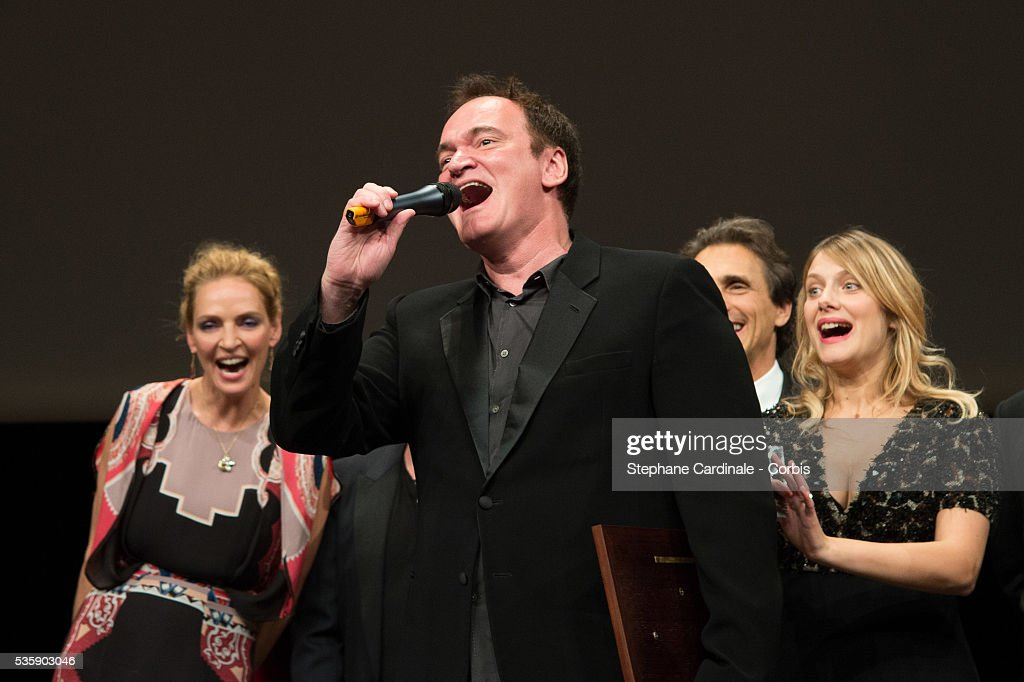US Director Quentin Tarantino delivers a speech next to Uma Thurman and Melanie Laurent, after receiving the Lumiere Award, during the 5th Lumiere Film Festival, in Lyon.