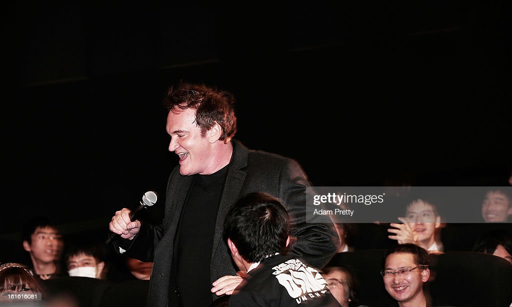 Director <a gi-track='captionPersonalityLinkClicked' href=/galleries/search?phrase=Quentin+Tarantino&family=editorial&specificpeople=171796 ng-click='$event.stopPropagation()'>Quentin Tarantino</a> greets fans before the special screening of 'Django Unchained' at Shinjuku Piccadilly on February 13, 2013 in Tokyo, Japan. The film will open on March 1 in Japan.