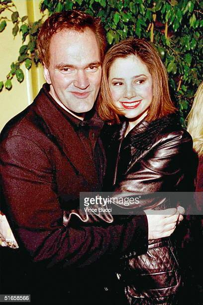 US director Quentin Tarantino hugs 11 December his girlfriend Academyaward winning actress Mira Sorvino at the premiere of Tarantino's latest movie...