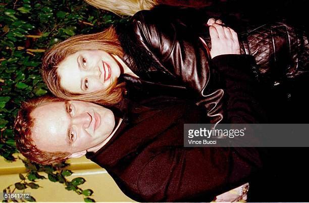 Director Quentin Tarantino hugs his girlfriend Academyawarding winning actress Mira Sorvino at the premiere of Tarantino's latest movie 'Jackie...