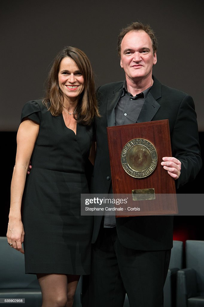 US Director Quentin Tarantino poses next to French Minister for Culture Aurelie Filippetti after receiving the Lumiere Award, during the 5th Lumiere Film Festival, in Lyon.