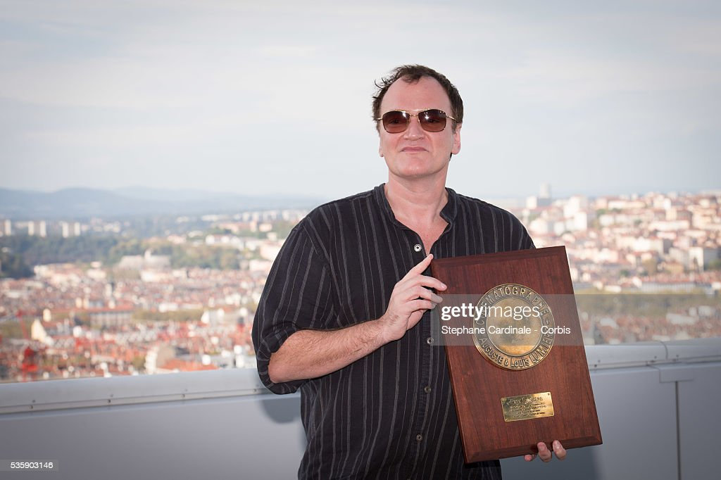 US Director Quentin Tarantino poses with the Lumiere Award, in front of a general view of the City of Lyon, during the 5th Lumiere Film Festival, in Lyon.