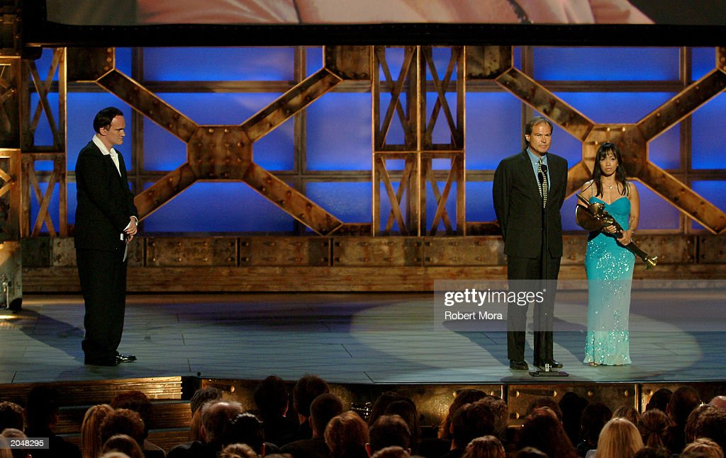 Director Quentin Tarantino presents the 'Best Overall Stunt by a Man' award to stuntman Harry O'Connor on stage during the 3rd Annual Taurus World Stunt Awards at Paramount Studios June 1, 2003 in Hollywood, California. Stuntman B.J. Worth and O'Connor's wife , Jenny, accpeted the award on his behalf. The show will air Monday, June 9th, 8:00 pm EST/PST on the USA Network.