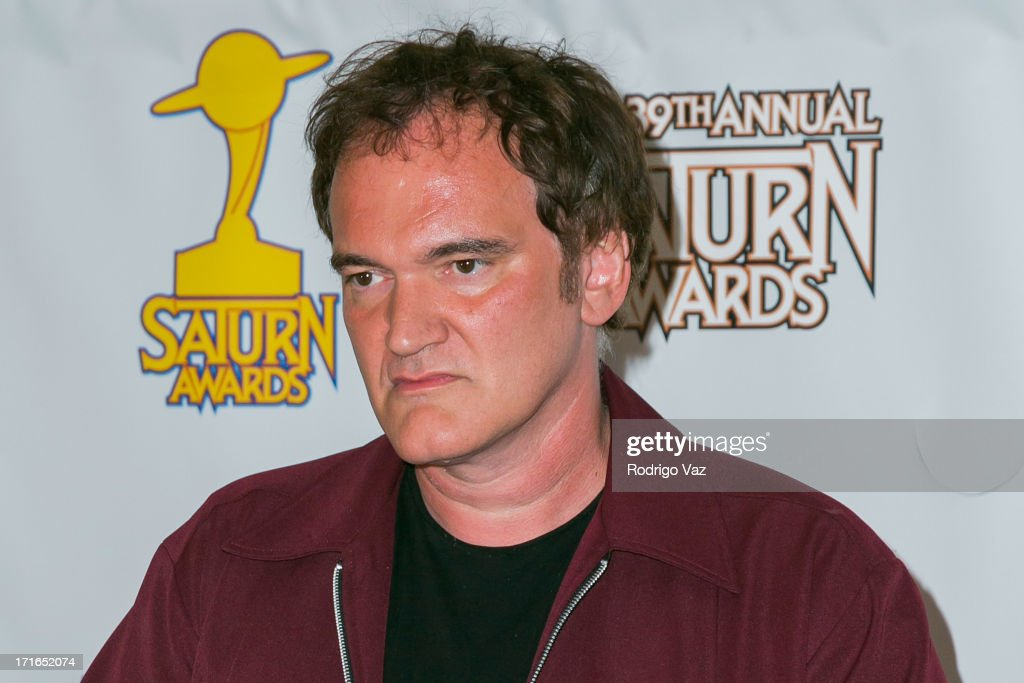 Director <a gi-track='captionPersonalityLinkClicked' href=/galleries/search?phrase=Quentin+Tarantino&family=editorial&specificpeople=171796 ng-click='$event.stopPropagation()'>Quentin Tarantino</a> receives an award at the 39th Annual Saturn Awards at The Castaway on June 26, 2013 in Burbank, California.