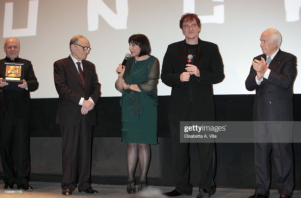 Director <a gi-track='captionPersonalityLinkClicked' href=/galleries/search?phrase=Quentin+Tarantino&family=editorial&specificpeople=171796 ng-click='$event.stopPropagation()'>Quentin Tarantino</a> receives Rome Film Festival Lifetime Achievement Award from Italian composer <a gi-track='captionPersonalityLinkClicked' href=/galleries/search?phrase=Ennio+Morricone&family=editorial&specificpeople=677347 ng-click='$event.stopPropagation()'>Ennio Morricone</a> (2nd L), <a gi-track='captionPersonalityLinkClicked' href=/galleries/search?phrase=Marco+Muller&family=editorial&specificpeople=829966 ng-click='$event.stopPropagation()'>Marco Muller</a> (L) and Paolo Ferrari (R) at Cinema Adriano on January 4, 2013 in Rome, Italy.