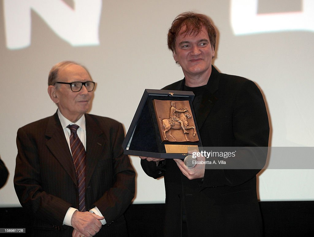 Director Quentin Tarantino (R) receives Rome Film Festival Lifetime Achievement Award from Italian composer Ennio Morricone at Cinema Adriano on January 4, 2013 in Rome, Italy.