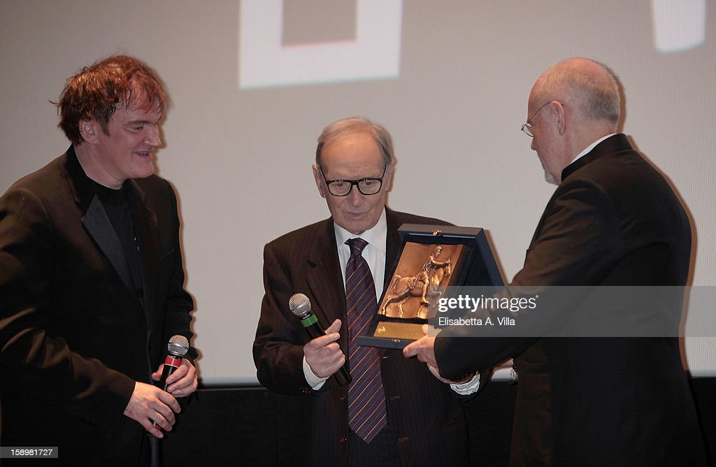 Director <a gi-track='captionPersonalityLinkClicked' href=/galleries/search?phrase=Quentin+Tarantino&family=editorial&specificpeople=171796 ng-click='$event.stopPropagation()'>Quentin Tarantino</a> receives Rome Film Festival Lifetime Achievement Award from Italian composer <a gi-track='captionPersonalityLinkClicked' href=/galleries/search?phrase=Ennio+Morricone&family=editorial&specificpeople=677347 ng-click='$event.stopPropagation()'>Ennio Morricone</a> (C) and Marco Muller (R) at Cinema Adriano on January 4, 2013 in Rome, Italy.