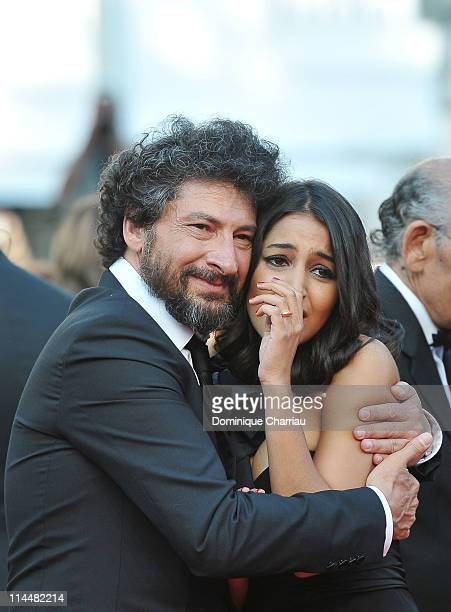 Director Radu Mihaileanu and actress Leila Bekhti attend the 'La Source Des Femmes' Premiere during the 64th Cannes Film Festival at the Palais des...