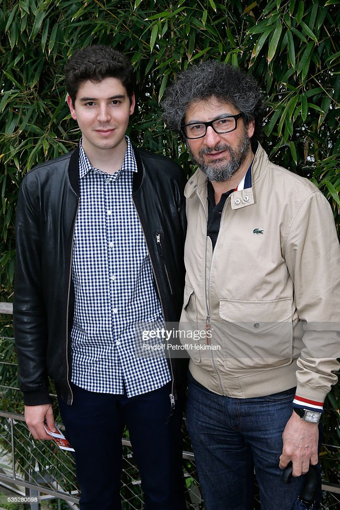 Director Radu Mihaileanu and his son Yuri attend Day Height of the 2016 French Tennis Open at Roland Garros on May 29, 2016 in Paris, France.