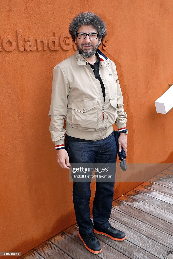 Director Radu Mihaileanu attends Day Height of the 2016 French Tennis Open at Roland Garros on May 29, 2016 in Paris, France.