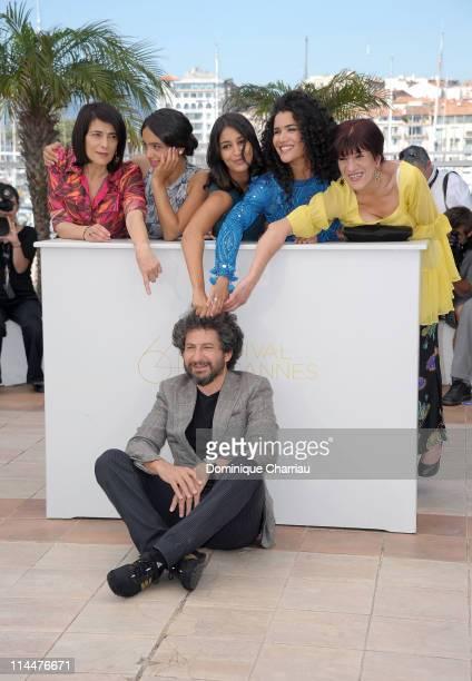 Director Radu Mihaileanu with actresses Hiam Abbas Hafsia Herzi Leila Bekhti Sabrina Ouazani and Biyouna attend 'La Source Des Femmes' Photocall...