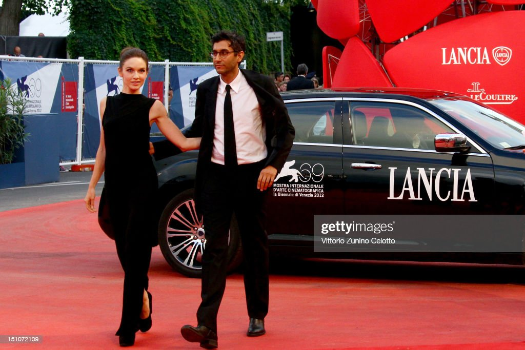 Director <a gi-track='captionPersonalityLinkClicked' href=/galleries/search?phrase=Ramin+Bahrani&family=editorial&specificpeople=4164720 ng-click='$event.stopPropagation()'>Ramin Bahrani</a> (R) and writer Hallie Elizabeth Newton attend the 'At Any Price' premiere during The 69th Venice Film Festival at the Palazzo del Cinema on August 31, 2012 in Venice, Italy.