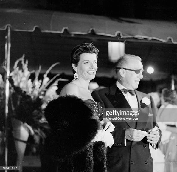 Director Raoul Walsh with Jane Russell attend the movie premiere of ' The Tall Men' in Los AngelesCA