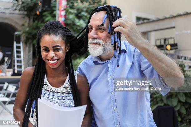 Director Riccardo Vannuccini and Joy Maso from Nigeria attend the rehearseal of AfricaBar stage show on July 31 2017 in Rome Italy Aim of this...