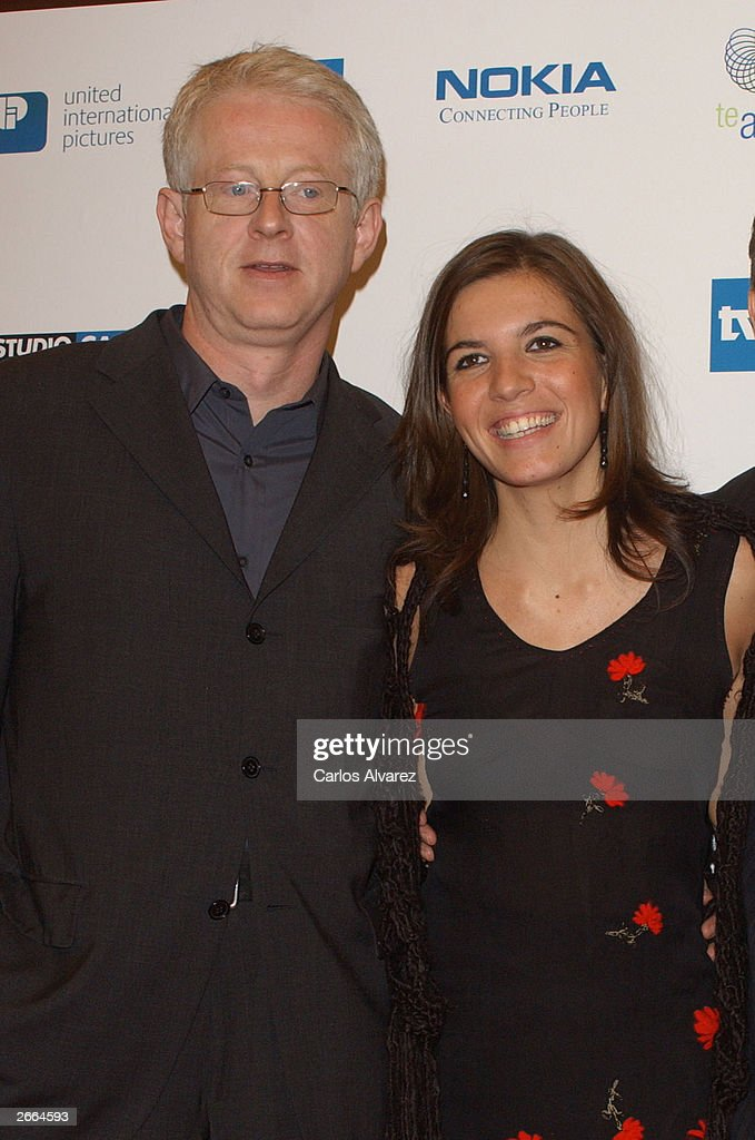 Director Richard Curtis and actress Lucia Moniz attend the premiere of his new movie 'Love Actually' at Palacio de la Musica Cinema October 27, 2003 in Madrid.