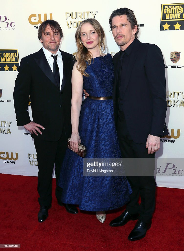 Director <a gi-track='captionPersonalityLinkClicked' href=/galleries/search?phrase=Richard+Linklater&family=editorial&specificpeople=242770 ng-click='$event.stopPropagation()'>Richard Linklater</a>, actress <a gi-track='captionPersonalityLinkClicked' href=/galleries/search?phrase=Julie+Delpy&family=editorial&specificpeople=201914 ng-click='$event.stopPropagation()'>Julie Delpy</a> and actor <a gi-track='captionPersonalityLinkClicked' href=/galleries/search?phrase=Ethan+Hawke&family=editorial&specificpeople=178274 ng-click='$event.stopPropagation()'>Ethan Hawke</a> attend the 19th Annual Critics' Choice Movie Awards at Barker Hangar on January 16, 2014 in Santa Monica, California.