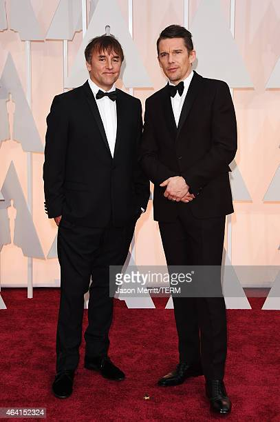 Director Richard Linklater and actor Ethan Hawke attend the 87th Annual Academy Awards at Hollywood Highland Center on February 22 2015 in Hollywood...