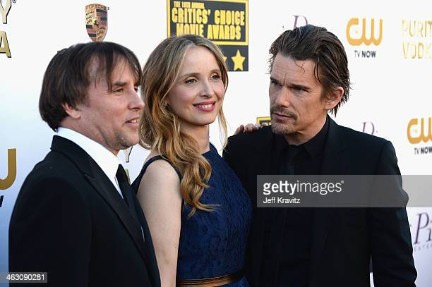 Director Richard Linklater and actors Julie Delpy and Ethan Hawke attend the 19th Annual Critics' Choice Movie Awards at Barker Hangar on January 16...