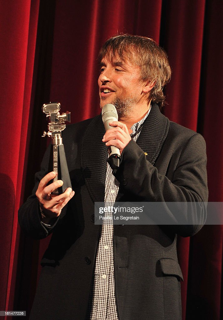 Director <a gi-track='captionPersonalityLinkClicked' href=/galleries/search?phrase=Richard+Linklater&family=editorial&specificpeople=242770 ng-click='$event.stopPropagation()'>Richard Linklater</a> is awarded a Berlinale Kamera after the 'Before Midnight' Premiere during the 63rd Berlinale International Film Festival at the Berlinale Palast on February 11, 2013 in Berlin, Germany.