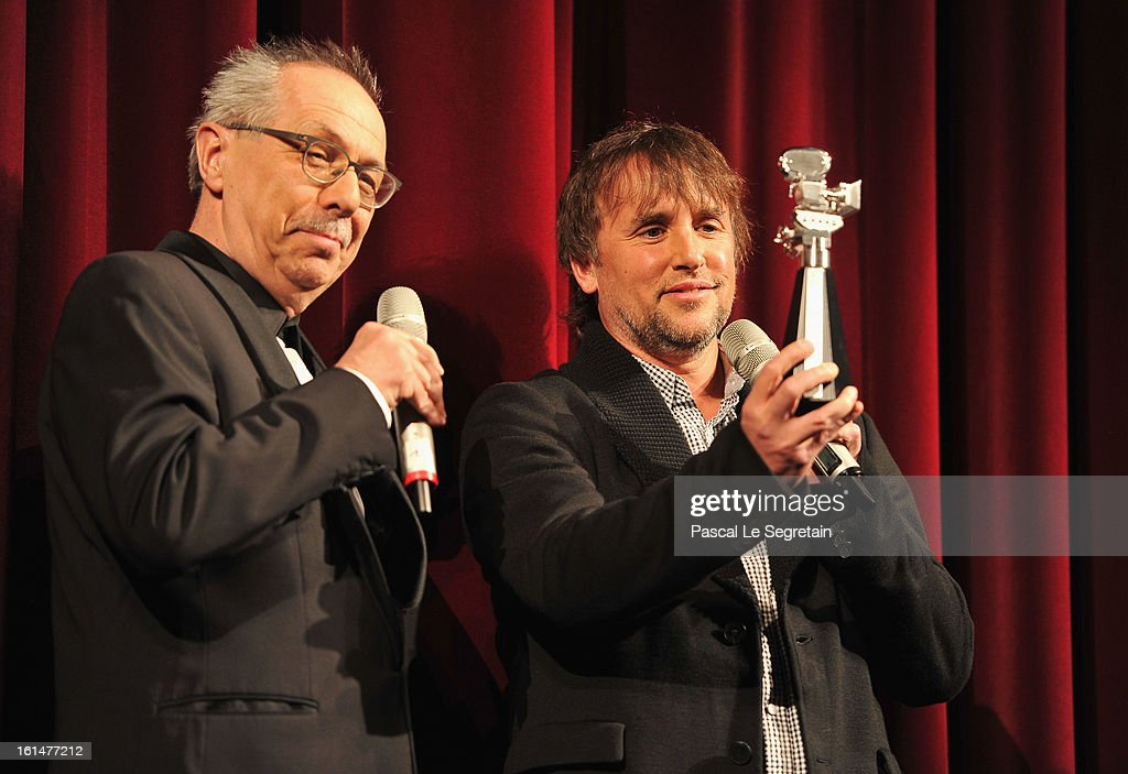 Director <a gi-track='captionPersonalityLinkClicked' href=/galleries/search?phrase=Richard+Linklater&family=editorial&specificpeople=242770 ng-click='$event.stopPropagation()'>Richard Linklater</a> is awarded a Berlinale Kamera by festival director Berlin Film Festival Director <a gi-track='captionPersonalityLinkClicked' href=/galleries/search?phrase=Dieter+Kosslick&family=editorial&specificpeople=213030 ng-click='$event.stopPropagation()'>Dieter Kosslick</a> after the 'Before Midnight' Premiere during the 63rd Berlinale International Film Festival at the Berlinale Palast on February 11, 2013 in Berlin, Germany.