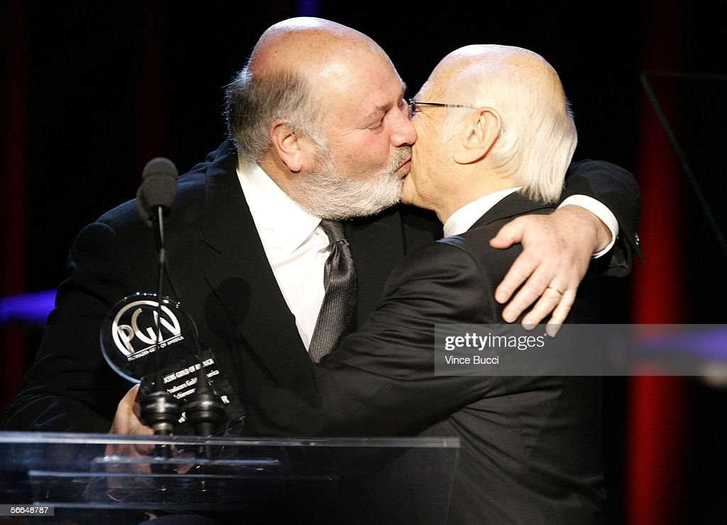 Director Rob Reiner kisses Producer Norman Lear as he presents him the Producers Guild Achievement Award in Television award onstage during the 2006...