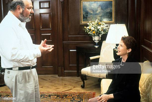 Director Rob Reiner talking to Annette Bening in between scenes from the film 'The American President' 1995