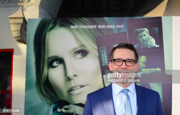 Director Rob Thomas poses on arrival for the film premiere of 'Veronica Mars' in Hollywood California on March 12 2014 The film opens on March 14 AFP...