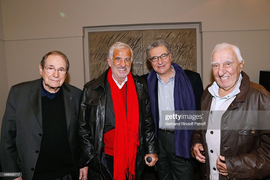 Director Robert Hossein, actor Jean-Paul Belmondo, Secretary General of the French cinematheque Serge Toubiana and actor Charles Gerard pose backstage following the show of impersonator Laurent Gerra 'Un spectacle Normal' at L'Olympia on December 20, 2013 in Paris, France.